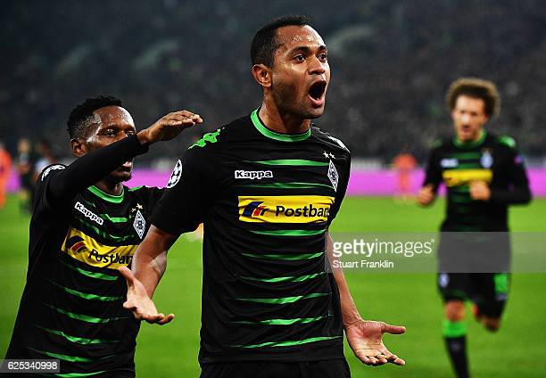 Raffael of Borussia Moenchengladbach is congratulated by Ibrahima Traore after scoring the first goal during the UEFA Champions League match between...