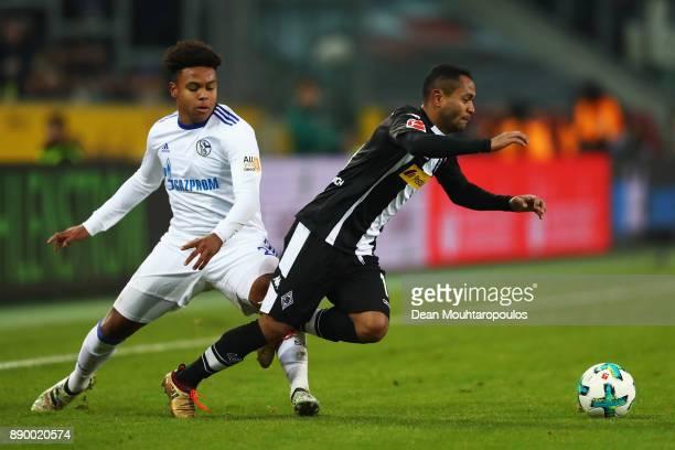 Raffael of Borussia Monchengladback gets past the tackle from Weston McKennie of Schalke 04 during the Bundesliga match between Borussia...