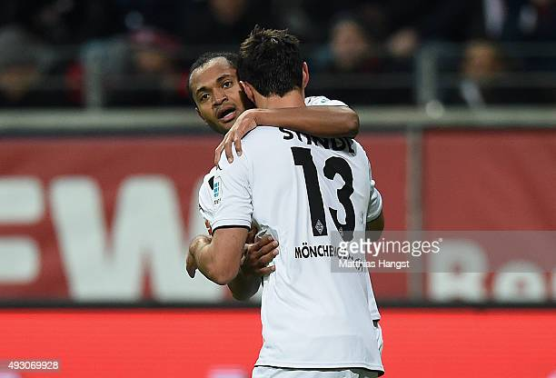 Raffael of Gladbach celebrates with his teammate Lars Stindl of Gladbach after scoring his team's first goal during the Bundesliga match between...
