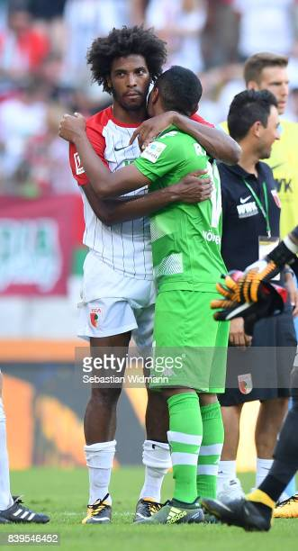 Raffael of Moenchengladbach and Caiuby of Augsburg embrace after the Bundesliga match between FC Augsburg and Borussia Moenchengladbach at WWKArena...