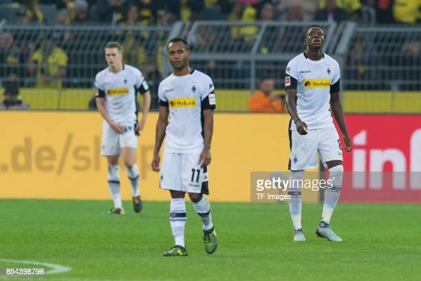 Raffael of Moenchengladbach and Denis Zakaria of Moenchengladbach looks dejected during the Bundesliga match between Borussia Dortmund and Borussia...