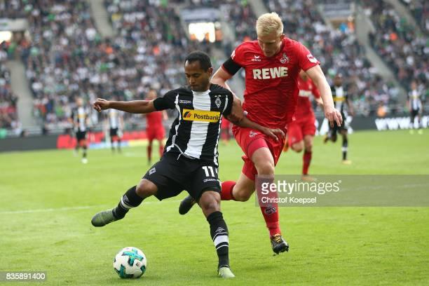 Raffael of Moenchengladbach and Frederik Sorensen of Koeln during the Bundesliga match between Borussia Moenchengladbach and 1 FC Koeln at...