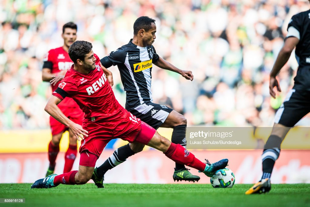 Raffael (R) of Moenchengladbach and Jonas Hector (L) of Koeln fight for the ball during the Bundesliga match between Borussia Moenchengladbach and 1. FC Koeln at Borussia-Park on August 20, 2017 in Moenchengladbach, Germany.
