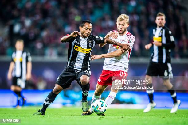 Raffael of Moenchengladbach and Konrad Laimer of Leipzig in action during the Bundesliga match between RB Leipzig and Borussia Moenchengladbach at...