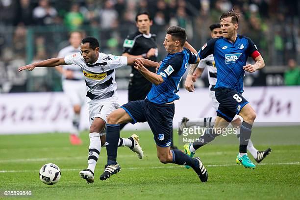 Raffael of Moenchengladbach battles for the ball with Fabian Schaer of Hoffenheim during the Bundesliga match between Borussia Moenchengladbach and...