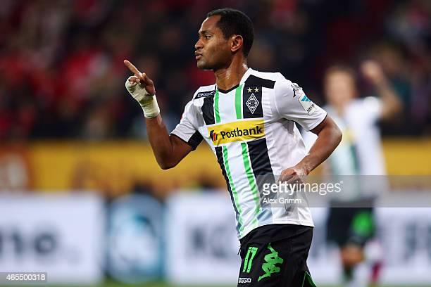 Raffael of Moenchengladbach celebrates his team's first goal during the Bundesliga match between 1 FSV Mainz 05 and Borussia Moenchengladbach at...