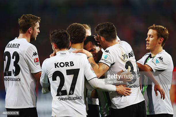 Raffael of Moenchengladbach celebrates his team's first goal with team mates during the Bundesliga match between 1 FSV Mainz 05 and Borussia...