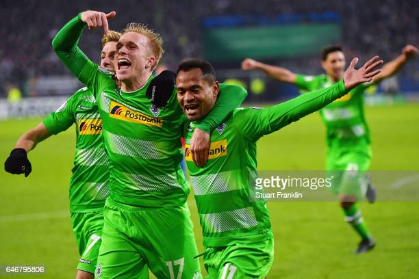 Raffael of Moenchengladbach celebrates his team's second goal with team mate Oscar Wendt during the DFB Cup quarter final between Hamburger SV and...