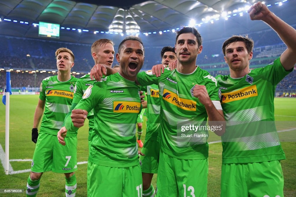 Raffael #11 of Moenchengladbach celebrates his team's second goal with team mates during the DFB Cup quarter final between Hamburger SV and Borussia Moenchengladbach at Volksparkstadion on March 1, 2017 in Hamburg, Germany.