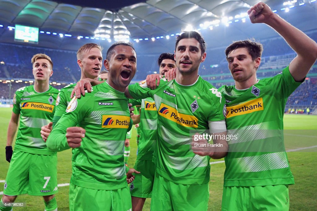 Raffael (front, L) of Moenchengladbach celebrates his team's second goal with team mates Lars Stindl (C) and Jonas Hofmann (R) during the DFB Cup quarter final between Hamburger SV and Borussia Moenchengladbach at Volksparkstadion on March 1, 2017 in Hamburg, Germany.