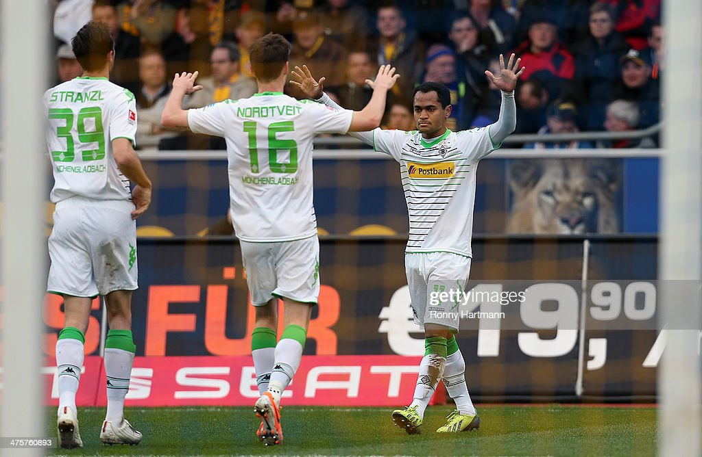 Raffael of Moenchengladbach celebrates scoring his team's opening goal with Havard Nordtveit and <a gi-track='captionPersonalityLinkClicked' href=/galleries/search?phrase=Martin+Stranzl&family=editorial&specificpeople=674140 ng-click='$event.stopPropagation()'>Martin Stranzl</a> of Moenchengladbach during the Bundesliga match between Eintracht Braunschweig and Borussia Moenchengladbach at Eintracht Stadion on March 1, 2014 in Braunschweig, Germany.