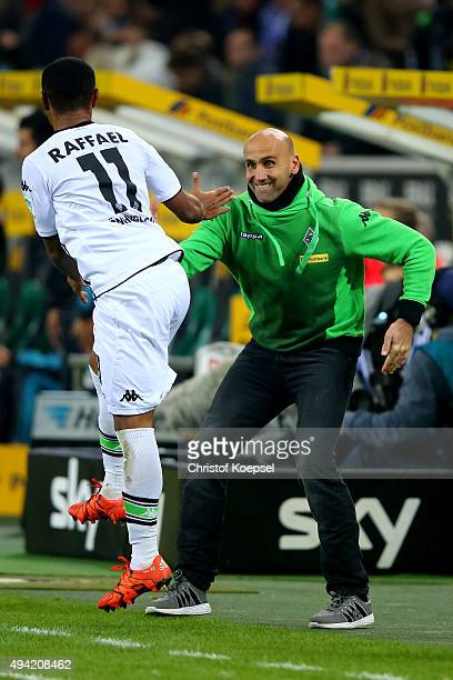 Raffael of Moenchengladbach celebrates the second goal with head coach Andre Schubert of Moenchengladbach during the Bundesliga match between...