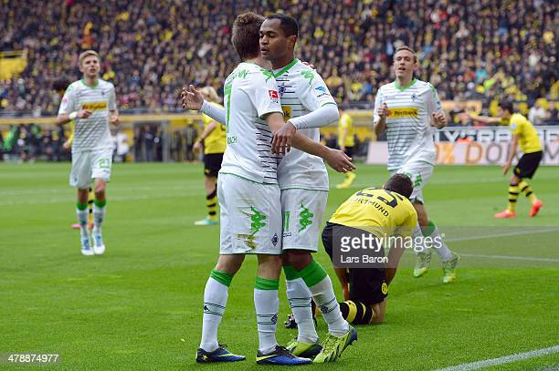 Raffael of Moenchengladbach celebrates with team mate Patrick Herrmann after scoring his teams first goal during the Bundesliga match between...