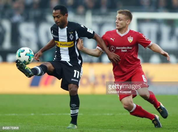 Raffael of Moenchengladbach fights for the ball with Santiago Ascacibar of Stuttgart during the Bundesliga match between Borussia Moenchengladbach...