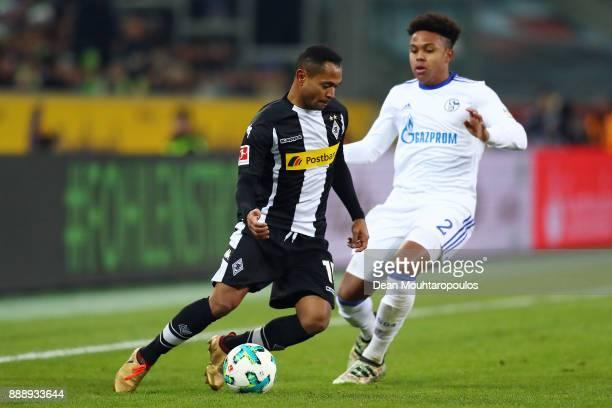 Raffael of Moenchengladbach fights for the ball with Weston McKennie of Schalke during the Bundesliga match between Borussia Moenchengladbach and FC...