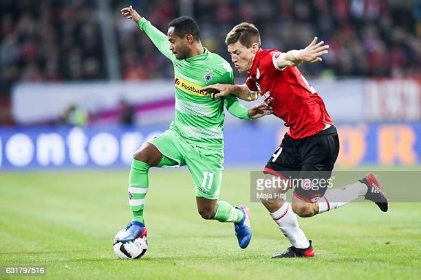 Raffael of Moenchengladbach is challenged by Gaetan Bussmann of Mainz during the Telekom Cup 2017 match between Borussia Moenchengladbach and 1 FSV...