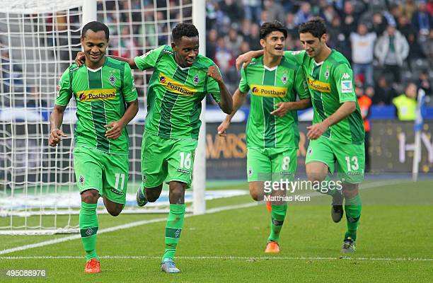 Raffael of Moenchengladbach jubilates with his team mates Ibrahima Traore Mahmoud Dahoud and Lars Stindl after scoring the second goal during the...
