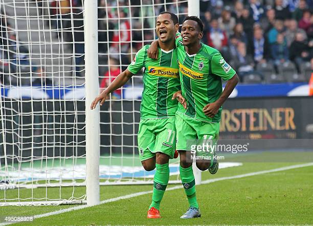 Raffael of Moenchengladbach jubilates with team mate Ibrahima Traore after scoring the second goal during the Bundesliga match between Hertha BSC and...