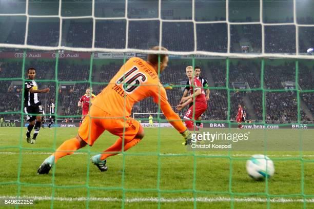 Raffael of Moenchengladbach scores the first goal against RonRobert Zieler Of Stuttgart during the Bundesliga match between Borussia Moenchengladbach...