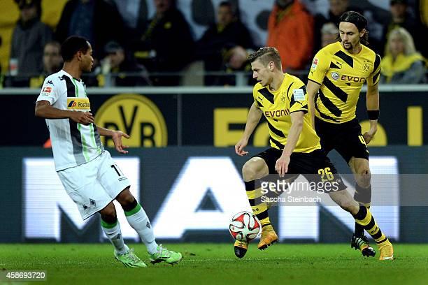 Raffael of Moenchengladbach vies with Lukasz Piszczek and Neven Subotic of Dortmund during the Bundesliga match between Borussia Dortmund and...