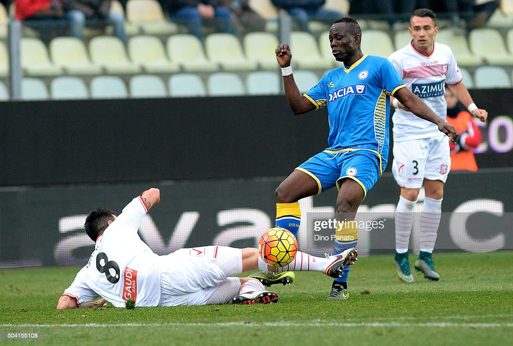 Raffaele Bianco (L) of Carpi FC competes with Emmanuel Agyemang Badu of Udinese Calcio during the Serie A match between Carpi FC and Udinese Calcio at Alberto Braglia Stadium on January 9, 2016 in Modena, Italy.