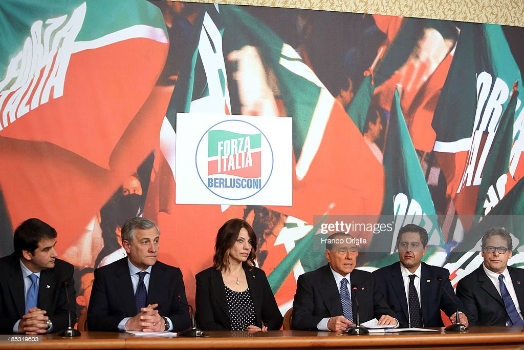 Raffaele Fitto, <a gi-track='captionPersonalityLinkClicked' href=/galleries/search?phrase=Antonio+Tajani&family=editorial&specificpeople=5429212 ng-click='$event.stopPropagation()'>Antonio Tajani</a>, Elisabetta Gardini, <a gi-track='captionPersonalityLinkClicked' href=/galleries/search?phrase=Silvio+Berlusconi&family=editorial&specificpeople=201842 ng-click='$event.stopPropagation()'>Silvio Berlusconi</a>, Giovanni Toti and Gianfranco Micciche attend a press conference to open the European electoral campaign of Berlusconi's party Forza Italia at the Forza Italia headquarters on April 17, 2014 in Rome, Italy. Berlusconi is not able to be a candidate himself due to legal issues, after he was sentenced to community service for tax fraud.