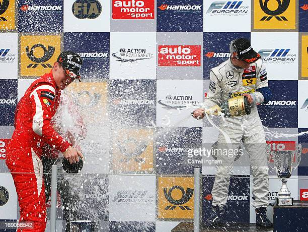 Raffaele Marcielo of Italy driver of the Prema Powerteam Dallara F312 Mercedes is showered in champagne by second placed Lucas Auer after winning the...