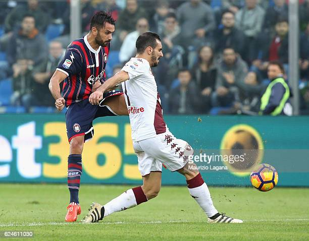 Raffaele Palladino of Crotone competes for the ball with Davide Zappacosta of Torino during the Serie A match between FC Crotone and FC Torino at...
