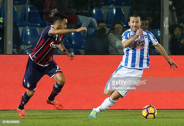 Raffaele Palladino of Crotone competes for the ball with Hugo Campagnaro of Pescara during the Serie A match between FC Crotone and Pescara Calcio at...