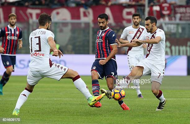 Raffaele Palladino of Crotone competes for the ball with Luca Rossettini and Davide Zappacosta of Torino during the Serie A match between FC Crotone...