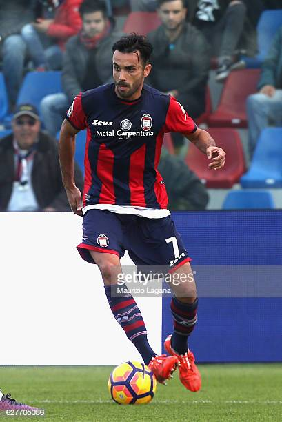 Raffaele Palladino of Crotone competes for the ball with Luis Muriel of Sampdoria during the Serie A match between FC Crotone and UC Sampdoria at...