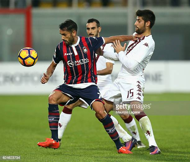 Raffaele Palladino of Crotone competes for the ball with Marco Benassi of Torino during the Serie A match between FC Crotone and FC Torino at Stadio...