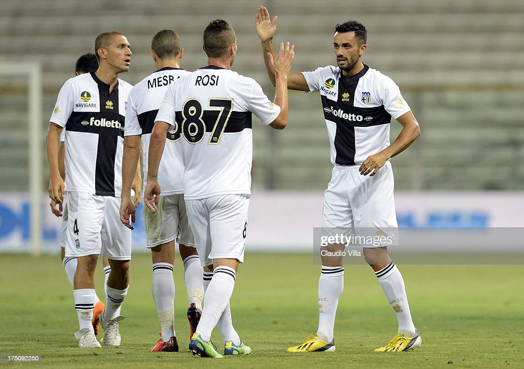 Raffaele Palladino of Parma FC (R) celebrates scoring the first goal during the pre-season friendly match between Parma FC and Olympique Marseille at Stadio Ennio Tardini on July 31, 2013 in Parma, Italy.