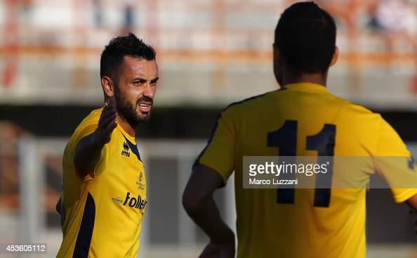 Raffaele Palladino of Parma FC celebrates with his teammates Ishak Belfodil after scoring the opening goal during the preseason friendly match...
