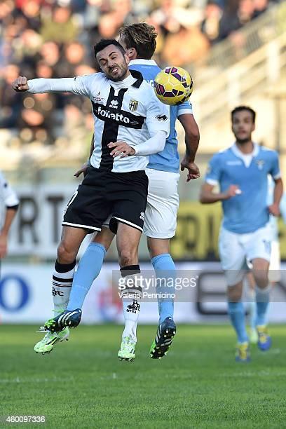 Raffaele Palladino of Parma FC clashes with Lucas Biglia of SS Lazio during the Serie A match between Parma FC and SS Lazio at Stadio Ennio Tardini...