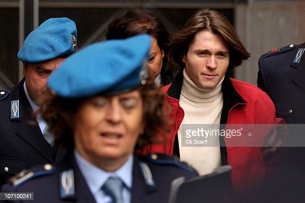 Raffaele Sollecito is led away from Perugia's Court of Appeal by police officers after the first session of his appeal against his murder conviction...