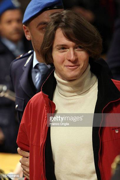 Raffaele Sollecito is led into Perugia's court of Appeal by a police officer for the first session of his appeal against his murder conviction on...