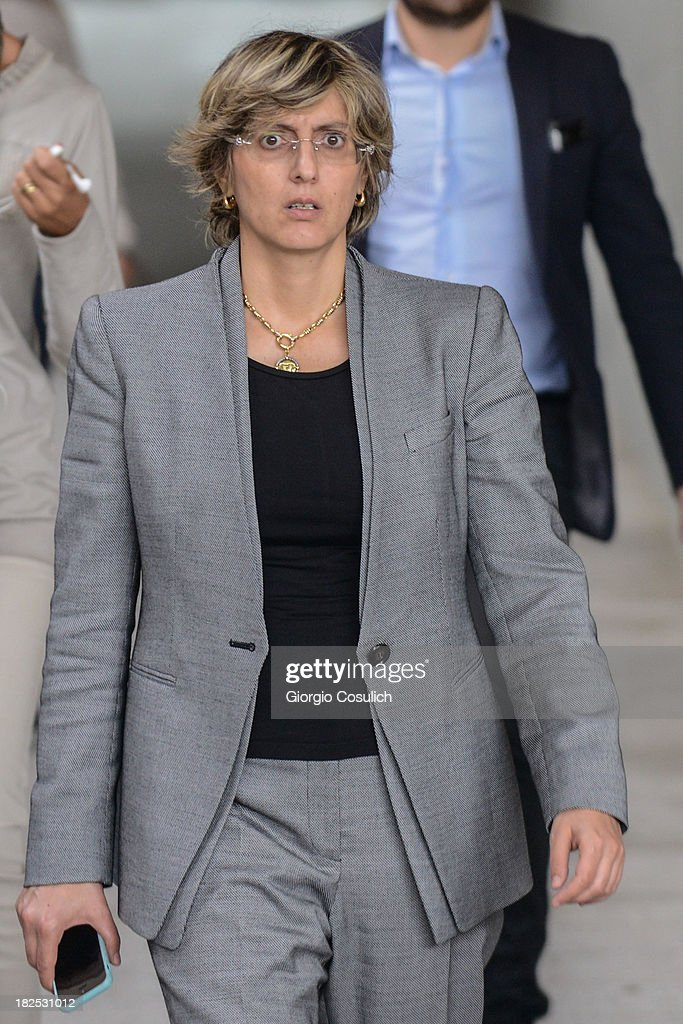 Raffaele Sollecito's defence lawyer, Giulia Bongiorno (C), leaves the new Courthouse during a time break of the appeal trial of Amanda Knox and Raffaele Sollecito on September 30, 2013 in Florence, Italy. Both Knox and Sollecito had their convictions overturned and were released in 2011 after four years in prison. Knox has no plans to return to Italy for their retrial and will be represented by her laywers in court.