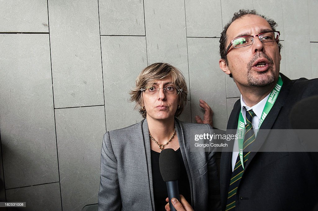 Raffaele Sollecito's defence lawyer, Giulia Bongiorno (C), talk to the media at the new Courthouse during a time break of the appeal trial of Amanda Knox and Raffaele Sollecito on September 30, 2013 in Florence, Italy. Both Knox and Sollecito had their convictions overturned and were released in 2011 after four years in prison. Knox has no plans to return to Italy for their retrial and will be represented by her laywers in court.