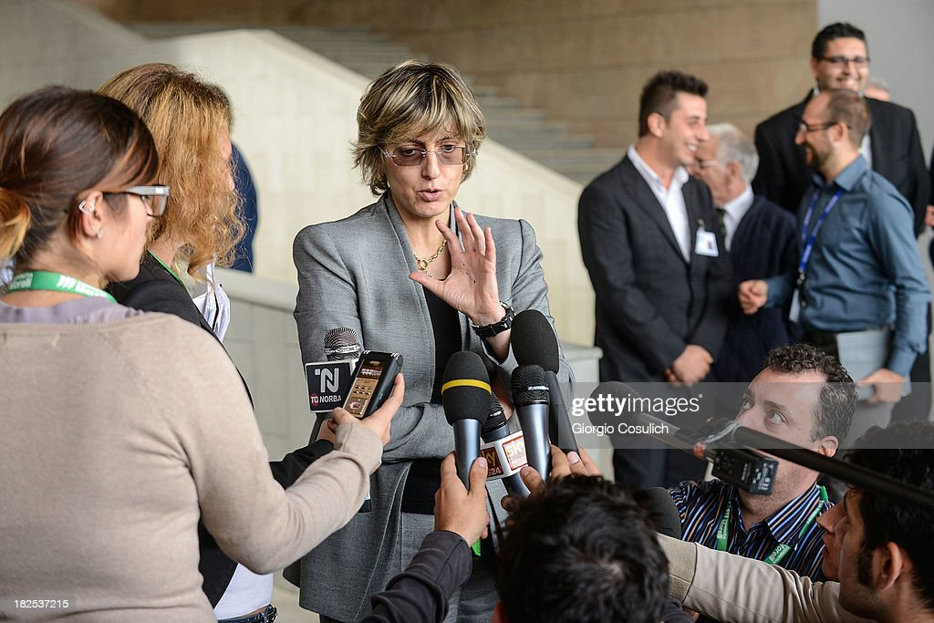 Raffaele Sollecito's defence lawyer, Giulia Bongiorno (C), talks to the media outside the new Courthouse during a break from the appeal trial of Amanda Knox and Raffaele Sollecito on September 30, 2013 in Florence, Italy. Both Knox and Sollecito had the convictions overturned and were released in 2011 after four years in prison. Knox has no plans to return to Italy for the retrial and will be represented by her laywers in court.