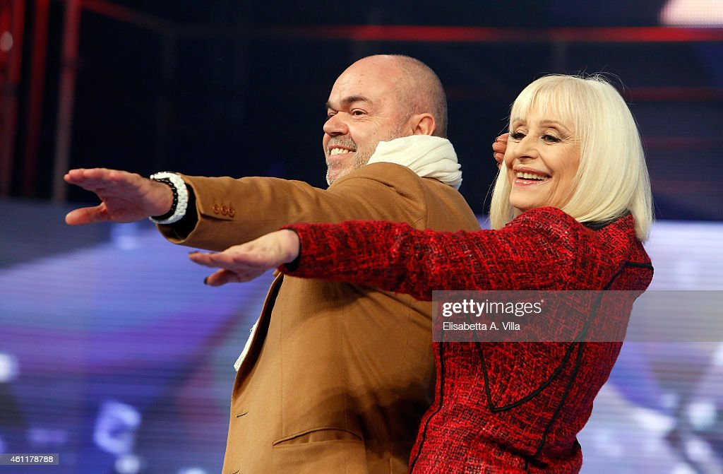 <a gi-track='captionPersonalityLinkClicked' href=/galleries/search?phrase=Raffaella+Carra&family=editorial&specificpeople=2838357 ng-click='$event.stopPropagation()'>Raffaella Carra</a> (R) and Sergio Iapino attend 'Forte Forte Forte' TV show photocall at RAI Voxon Studios on January 8, 2015 in Rome, Italy.