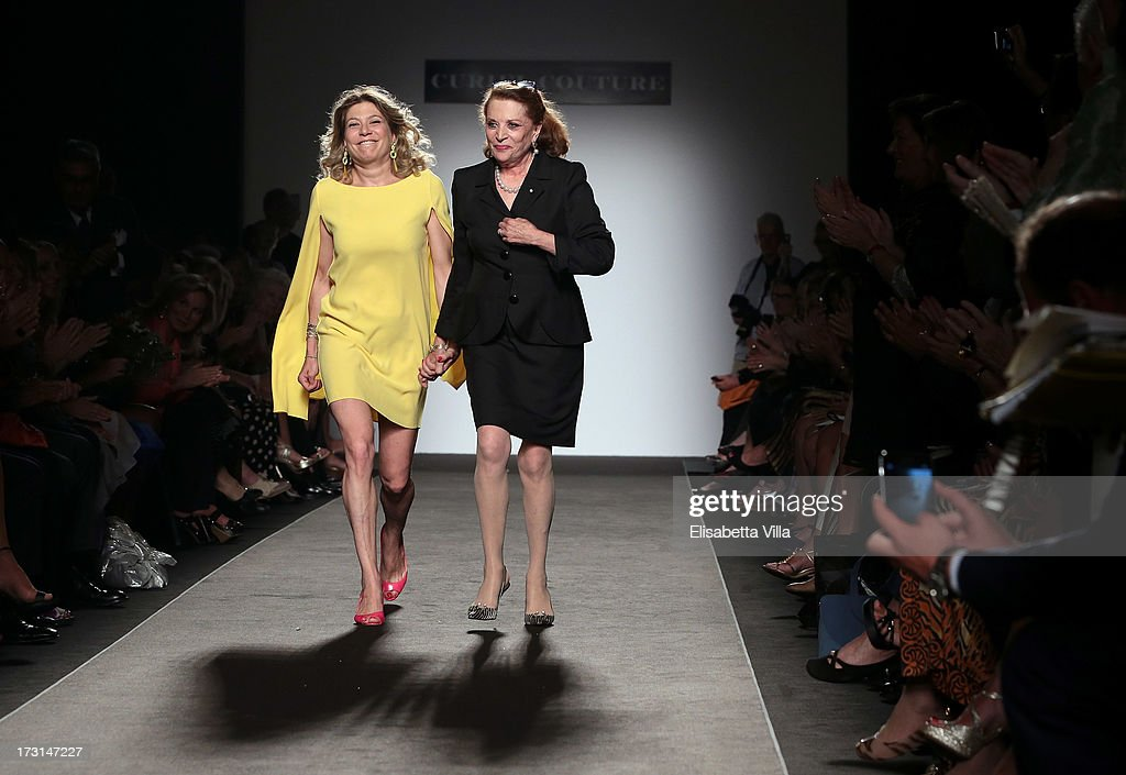 Raffaella Curiel (R) and daughter Gigliola Curiel walk the runway during Curiel Couture F/W 2013-2014 Haute Couture collection fashion show as part of AltaRoma AltaModa Fashion Week at Santo Spirito In Sassia on July 8, 2013 in Rome, Italy.