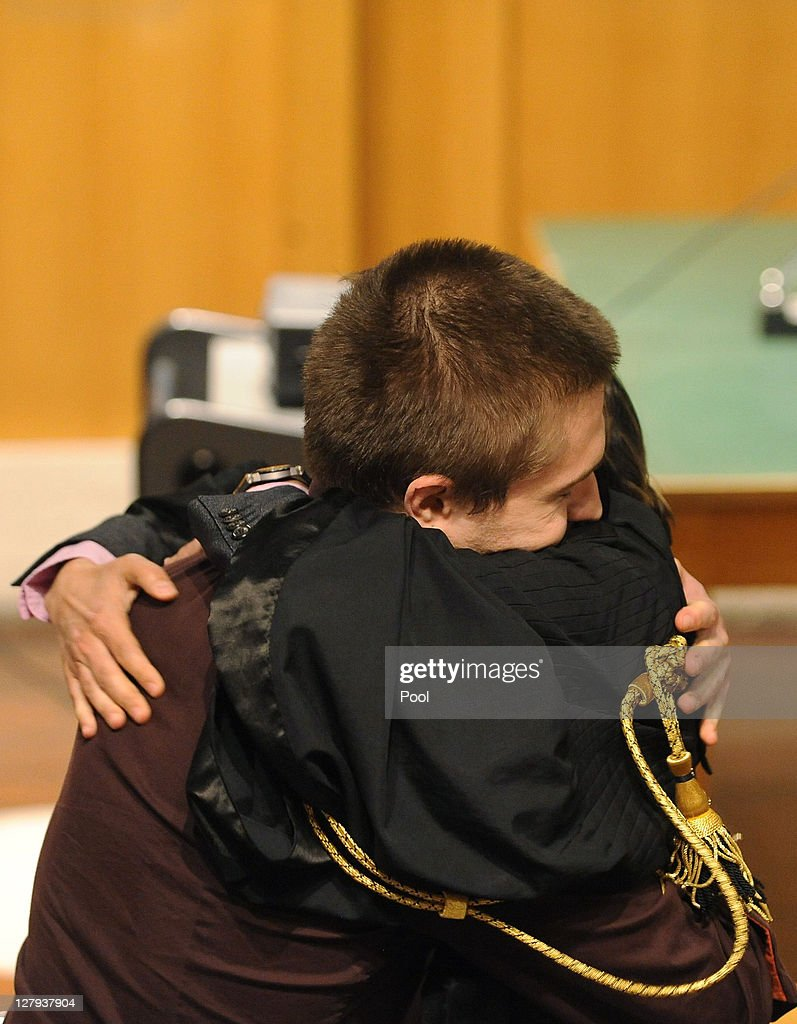Raffale Sollecito hugs Lawyer, Giulia Bongiorno after hearing the verdict that overturns his conviction and acquits him of murdering Meredith Kercher at the Perugia court on October 3, 2011 in Perugia, Italy. American student Amanda Knox and her Italian ex-boyfriend Raffaele Sollecito have won their appeal against their conviction in 2009 of killing their British roommate Meredith Kercher in Perugia, Italy in 2007. The pair had served nearly four years in jail after initially being sentenced to 26 and 25 years respectively.