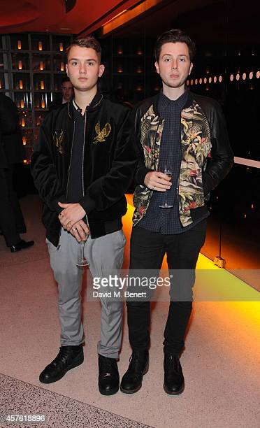 Rafferty Law and Fin Kemp attend the 50th Anniversary of Champagne Jacquart at Sushi Samba on October 21 2014 in London England