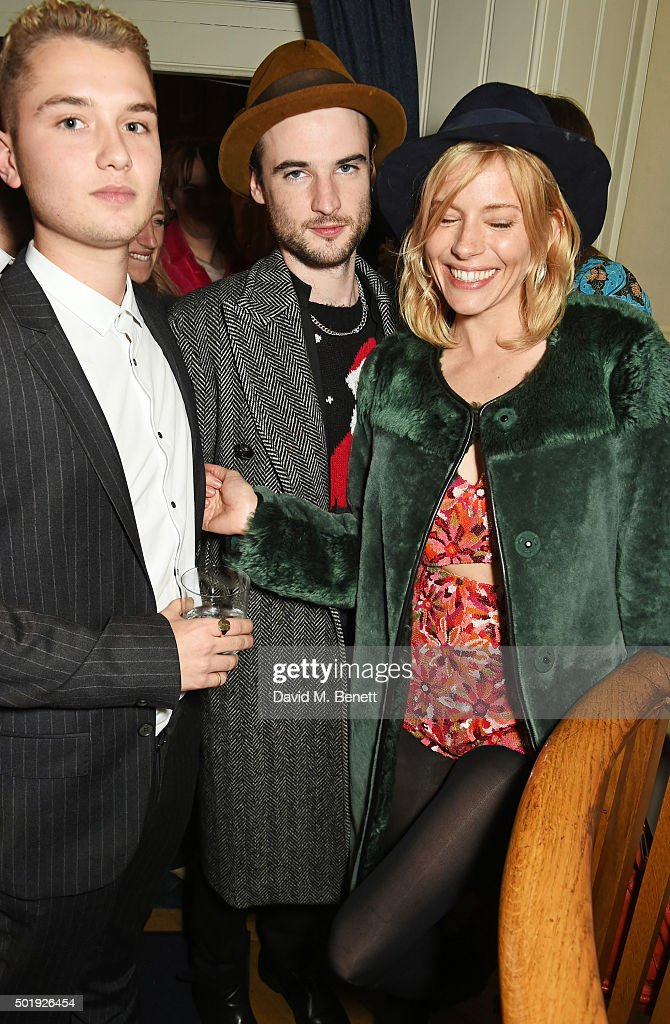 Rafferty Law, Tom Sturridge and Sienna Miller attend the LOVE Christmas party at George on December 18, 2015 in London, England.
