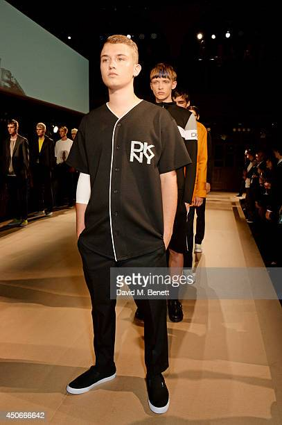 Rafferty Law walks the runway at the Esquire DKNY MEN official opening night party for London Collections Men at one Embankment on June 15 2014 in...