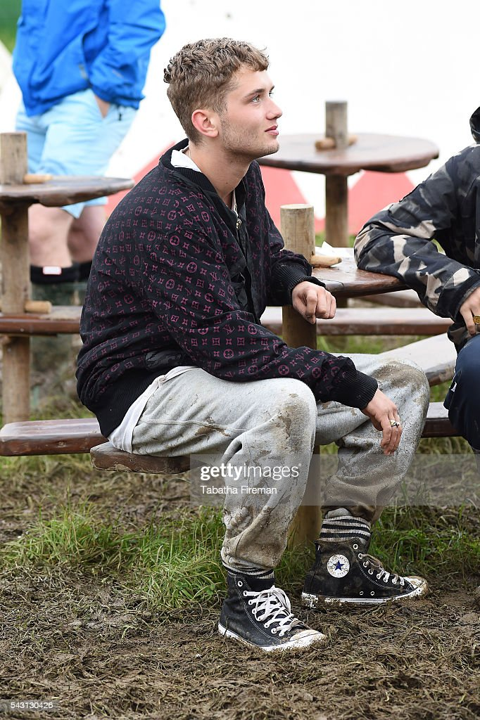 <a gi-track='captionPersonalityLinkClicked' href=/galleries/search?phrase=Rafferty+Law&family=editorial&specificpeople=2583013 ng-click='$event.stopPropagation()'>Rafferty Law</a> wears Converse at Glastonbury Festival 2016 at Glastonbury Festival Site on June 26, 2016 in Glastonbury, England.