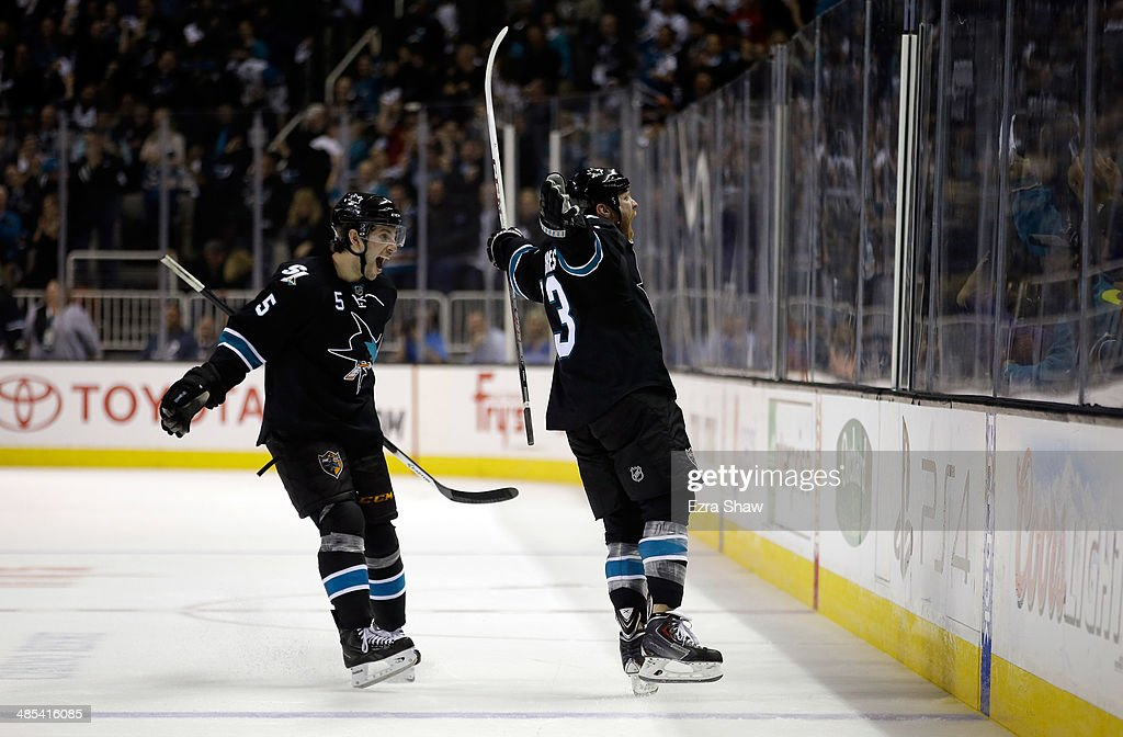 Raffi Torres and Jason Demers of the San Jose Sharks celebrate after Torres scored a goal against the Los Angeles Kings in Game One of the First...
