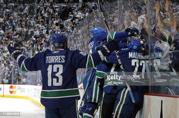 Raffi Torres Manny Malhotra Alexander Edler Kevin Bieksa celebrate Maxim Lapierre of the Vancouver Canucks third period goal during Game Five of the...
