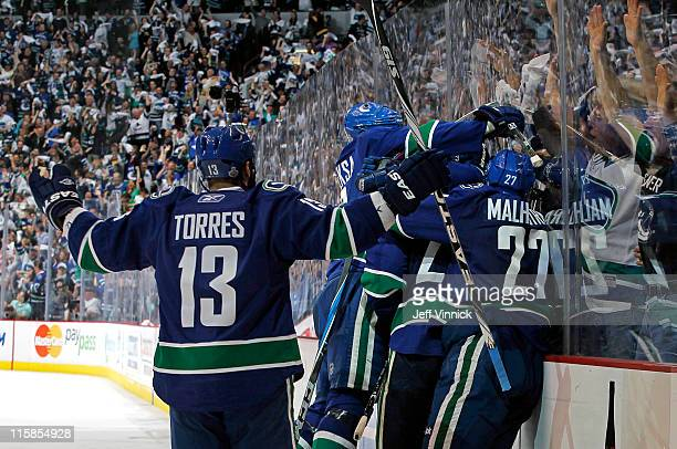 Raffi Torres Manny Malhotra Alexander Edler Kevin Bieksa celebrate Maxim Lapierre of the Vancouver Canucks third period goal during Game Five of the...